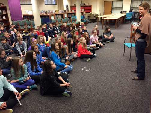 Orono alum Abby Fabiaschi talks with OMS sixth graders.