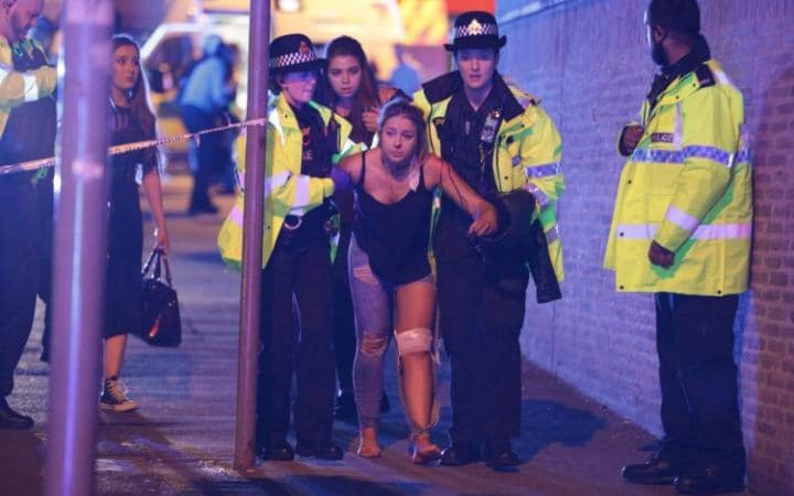 Officials+assist+the+wounded+after+an+explosion+targeted+fans+leaving+Ariana+Grande+concert+at+the+Manchester+Arena+in+England+on+Monday+night.+Joel+Goodman+%2F+REX%2FShutterstock+via+AP